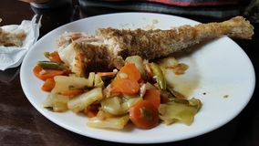 Eating of baked cod with vegetables stock video footage