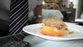 Eating baklava stock video
