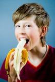 Eating a banana Stock Image