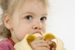 Eating banana stock photo