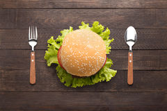Eating bbq burger on the wooden background Royalty Free Stock Photo
