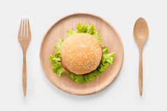 Eating bbq burger on wooden dish isolated on white background. Stock Photo