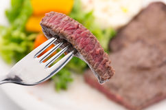 Eating Beef Round Steak Stock Photo