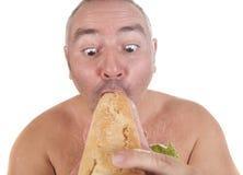 Eating big snack Stock Image