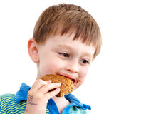 Eating biscuit. Three year old boy eating a chocolate biscuit Stock Photo