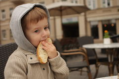 Eating boy. A boy,eating white bread Stock Photo