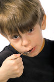 Eating boy. The boy is having his breakfast Stock Photography
