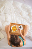 Eating breakfast in bed Royalty Free Stock Image