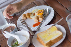 Eating breakfast in hostelry Stock Photo