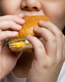 Eating a burger Stock Photography