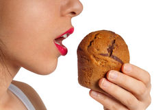 Eating Cake Isolated. Isolated photo of a beautiful girl eating a big cake, with an open mouth. Eating disorder concept. Clipping path included in .jpeg Royalty Free Stock Image