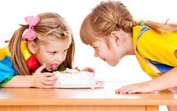 Eating a cake Royalty Free Stock Images