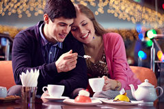 Eating cake in cafe Royalty Free Stock Images