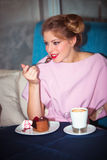 Eating a cake Royalty Free Stock Photography