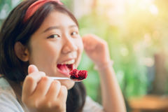Eating cake enjoy and smile happy people. Eating cake. cute asian young pritty tubby woman eat dessert in cafe Stock Image