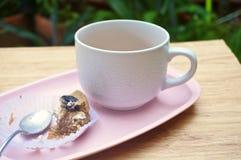 Eating cake with tea in garden Stock Photos