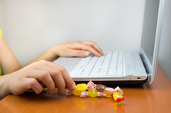 Eating candy at the work Stock Photography