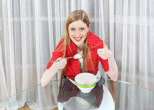 Eating cereals Stock Images