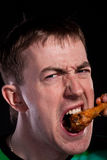 Eating chicken Royalty Free Stock Photography