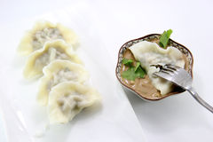 Eating Chinese dumpling Stock Images