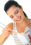 Eating Chinese Food With Chopstick. Young attractive woman eating chinese food with chopstick stock images