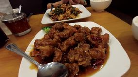 Chinese Sesame Chicken. Eating Chinese sweet fried sesame chicken bites stock footage