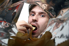 Eating chips Royalty Free Stock Image