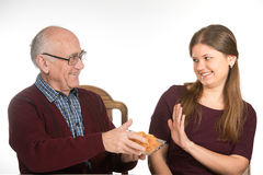 Eating chips. Old senior men and young women eating potato  chips Stock Photography