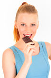 Eating a chocolat bar woman. Eating a chocolat bar cheerful woman. Very crisp and fresh photo Stock Photos
