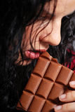 Eating chocolate Royalty Free Stock Photography