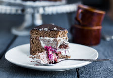 Eating chocolate cake with butter cream and cherries, birthday Stock Photography