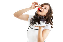 Eating chocolate cake with cherry Stock Photography