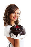 Eating chocolate cake with cherry Royalty Free Stock Images
