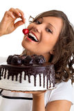 Eating chocolate cake with cherry Stock Image