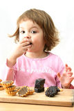 Eating chocolate cakes Royalty Free Stock Image
