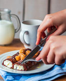 Eating chocolate pancakes with cottage cheese and berries Stock Image