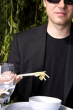 Eating with chop sticks Stock Photo