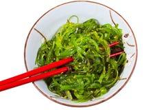 Eating of chuka seaweed salad Stock Images