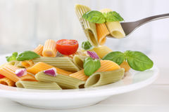 Eating colorful Penne Rigate noodles pasta meal stock photography