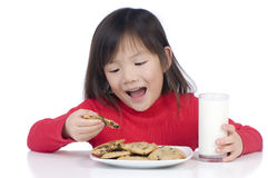 Eating Cookies Stock Images
