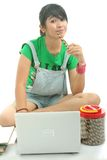 Eating cookies. Young woman eating cookies isolated Stock Image