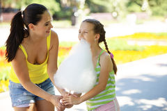 Eating cotton candy Royalty Free Stock Images