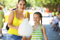 Eating cotton candy Royalty Free Stock Image