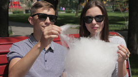 Eating Cotton Candy In The Park stock footage