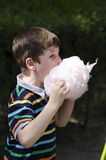 Eating cotton candy Stock Photo