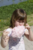 Eating cotton candy Stock Images