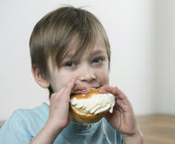 Eating cream bun Royalty Free Stock Photo