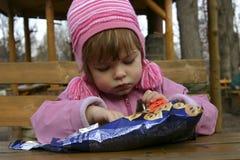 Eating crisps Stock Photo