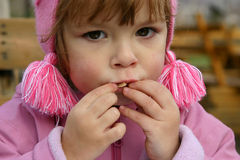Eating crisps. Child eating potato chips outdoors Royalty Free Stock Photography