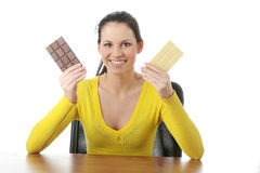 Eating dark and whitechocolate Stock Images